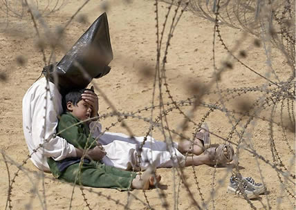 An Iraqi prisoner of war tries to calm down his child