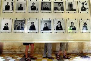 Tourists look at pictures of Khmer Rouge victims at the Toalsleng Genocide Museum in Phnom Penh, a former prison where an estimated 16,000 people were tortured and executed during the 1975-79 Khmer Rouge regime. The United States supplied arms to the Khmer Rouge after its defeat by Vietnamese troops and, amid Cold War politics, supported its keeping a seat at the United Nations despite knowing about the atrocities.